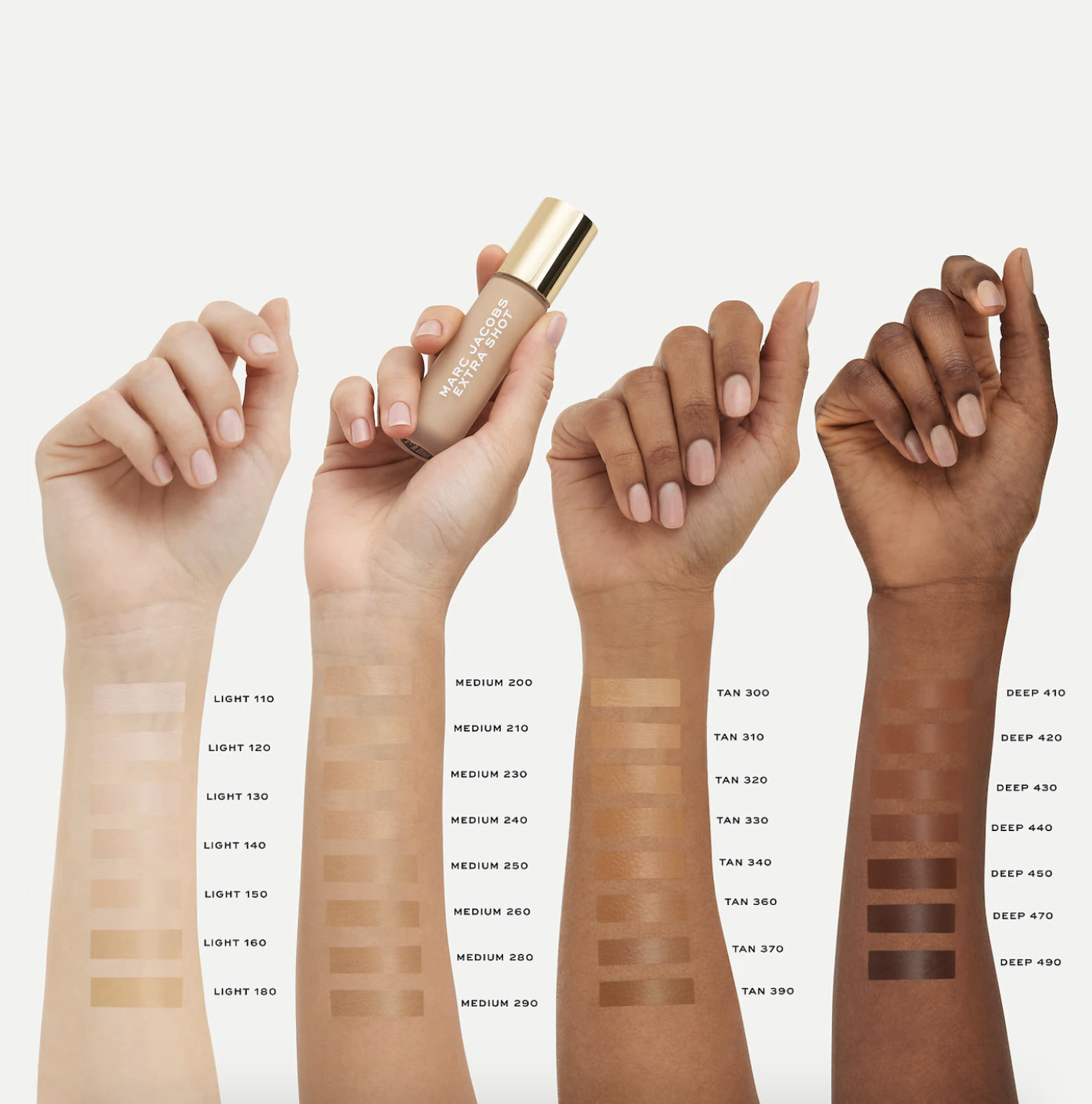 concealers swatched on four different skin tones