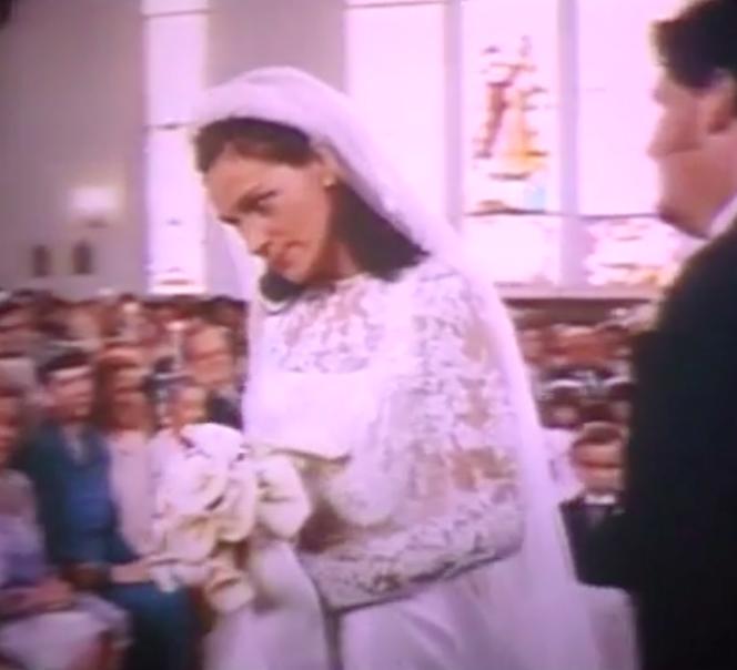 Maggie wearing a long-sleeve wedding dress