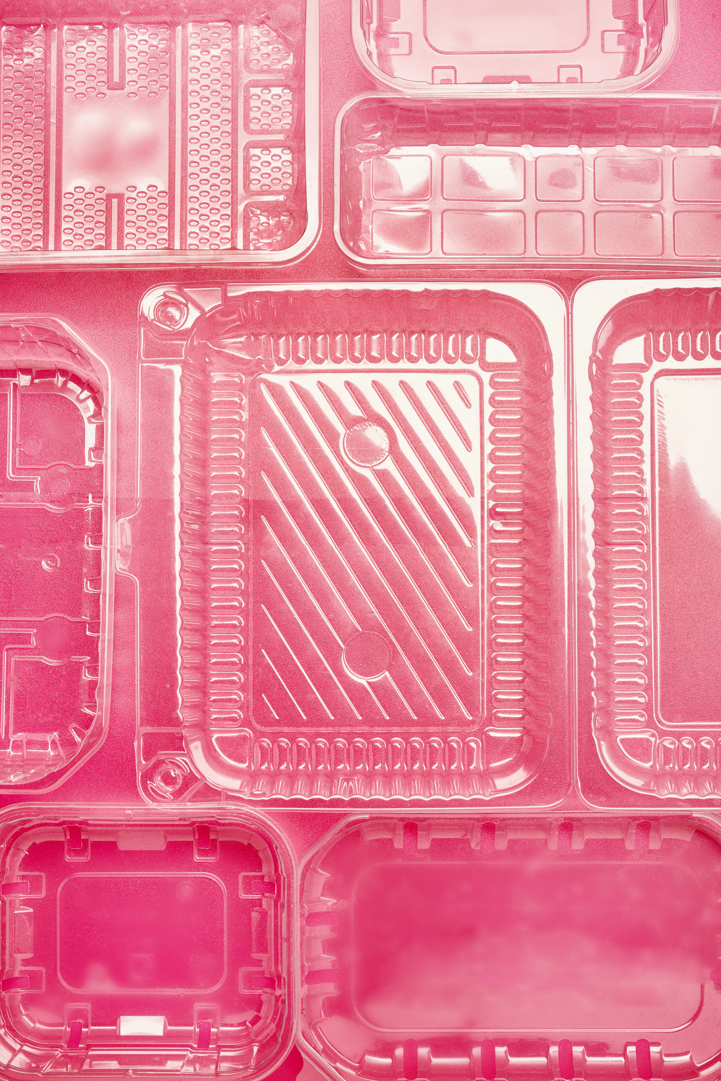 Overhead view of plastic containers of different sizes lined up together