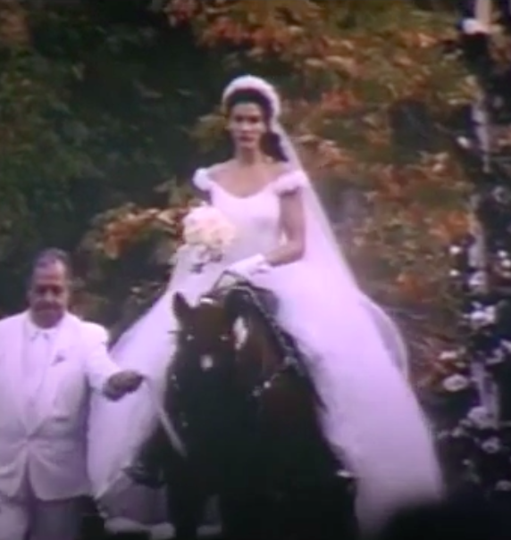 Maggie wearing an off-the-shoulder ballgown