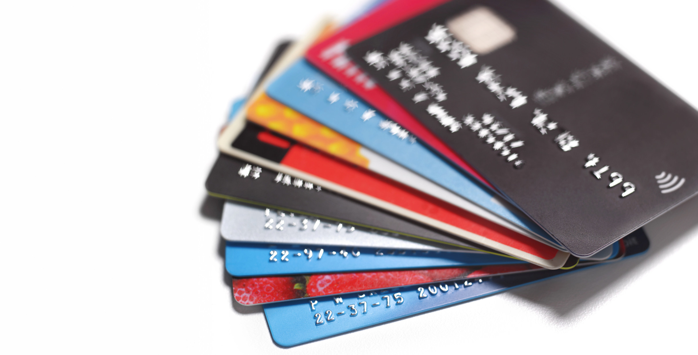 A fan of credit cards of multiple colors
