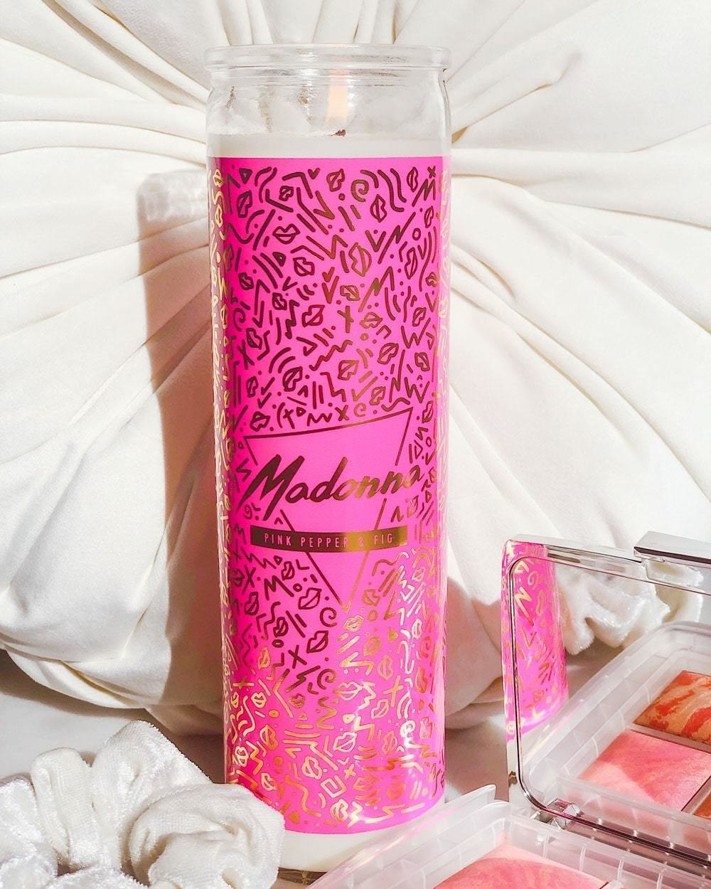 """tall votive candle with """"Madonna"""" on front"""