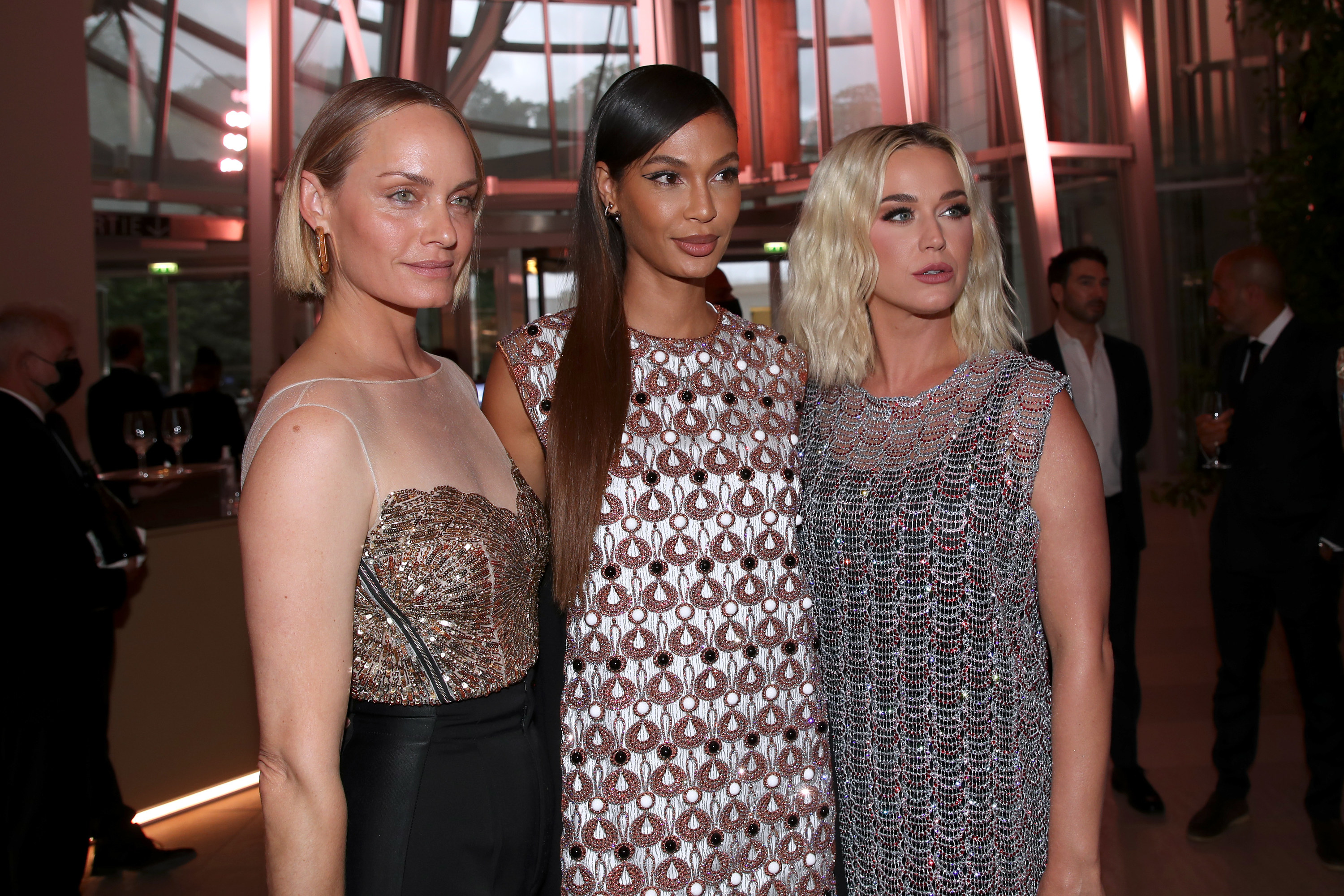 Amber Valletta, Joan Smalls, and Katy Perry are photographed at a Louis Vuitton event in Paris