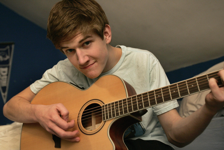 Bo playing acoustic guitar