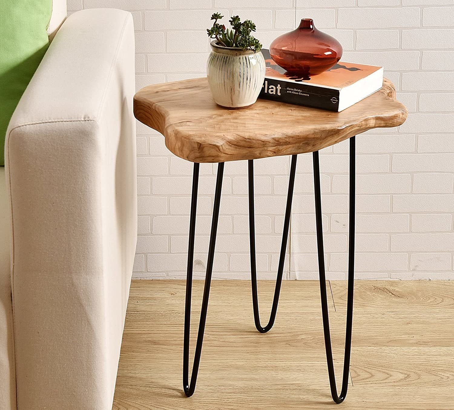 the side table with a natural edge wooden top with black steel legs