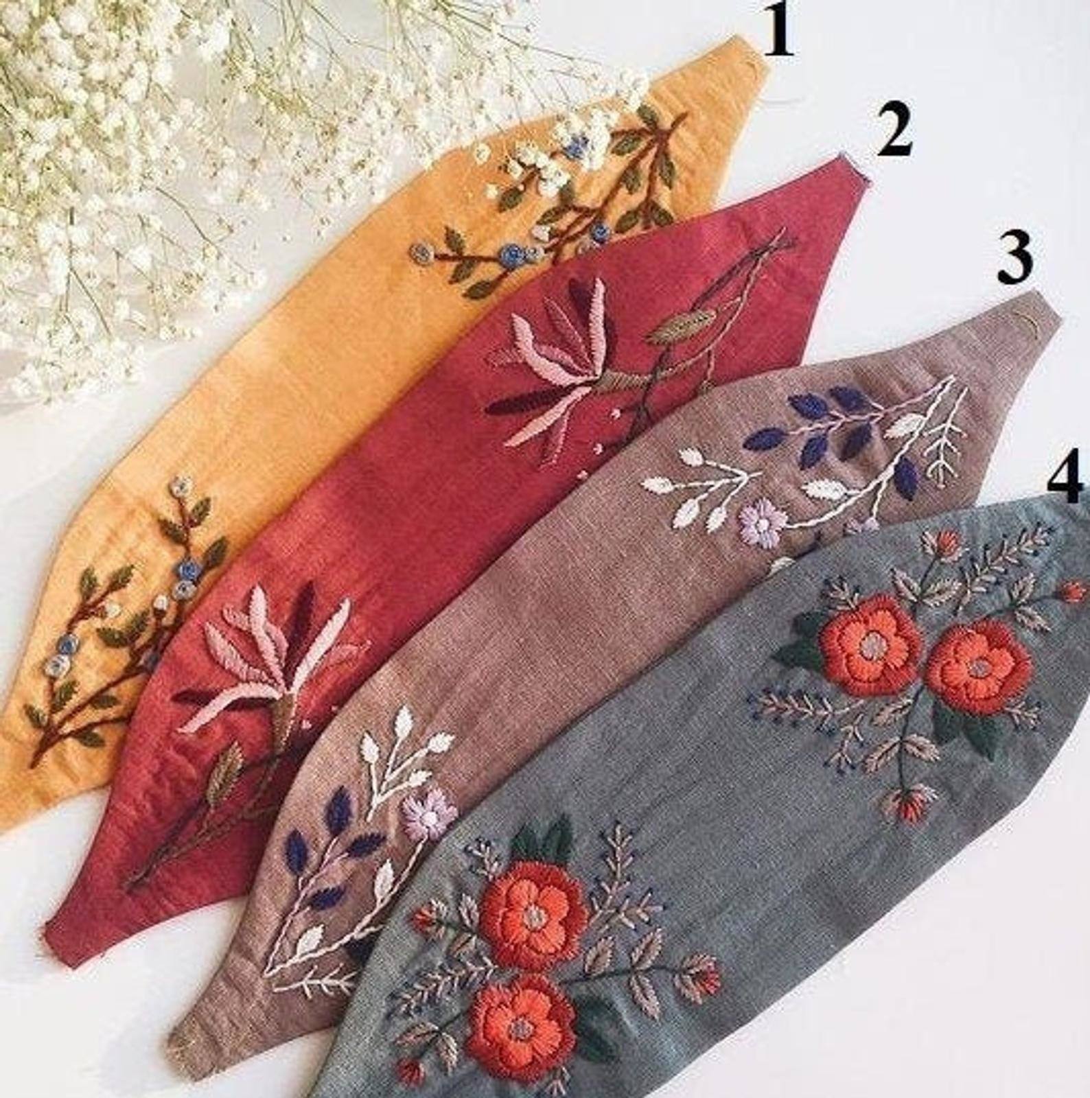 Four embroidered headbands in various colors