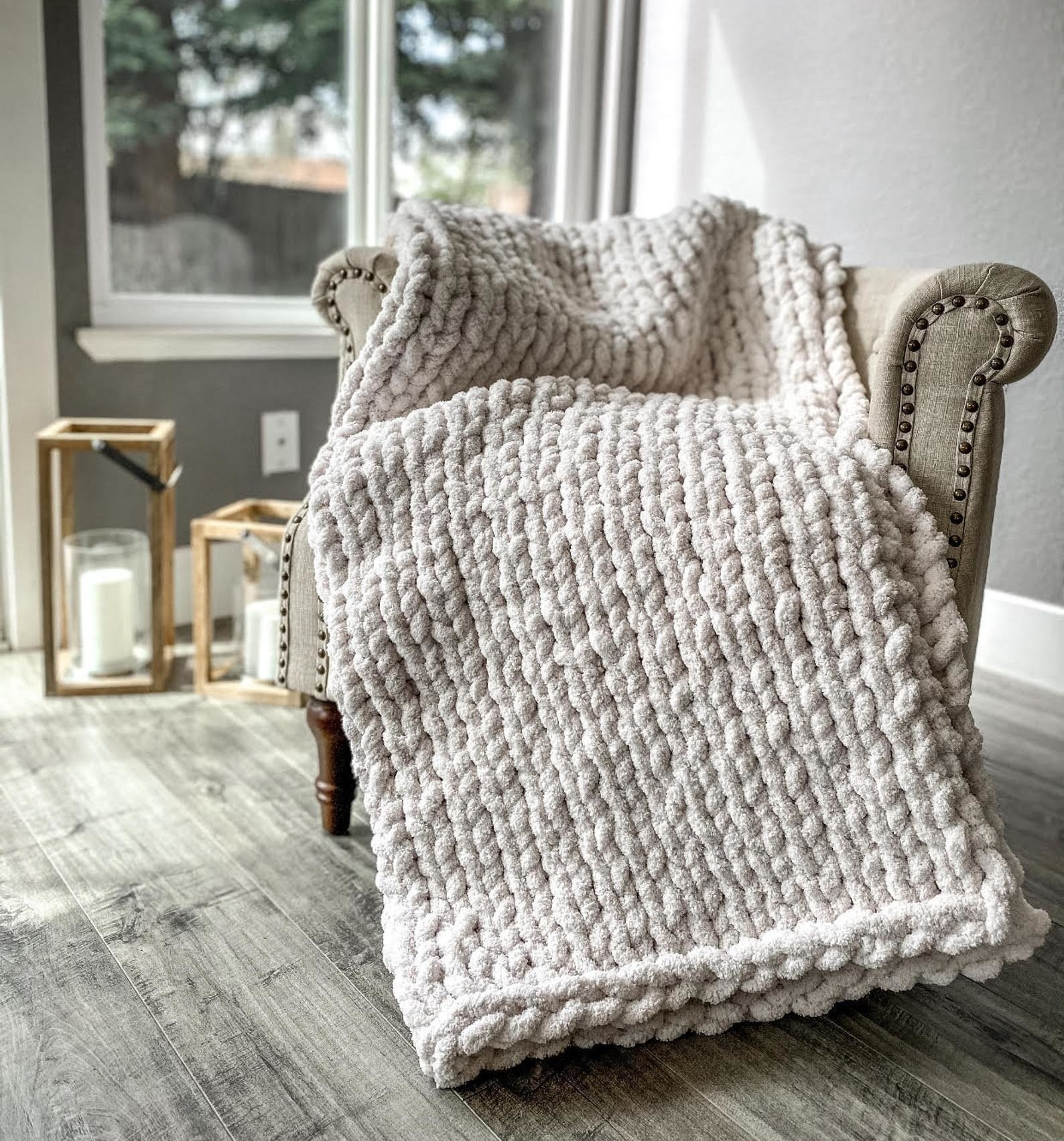 The chunky knit blanket in a cream color