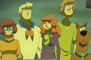 Velma, Fred, Daphne, Shaggy, and Scooby stare worriedly out into the distance.