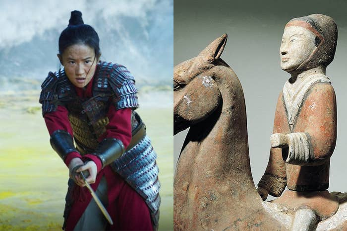 Mulan wearing shiny plated metal armor, but the statue of a knight is wearing a plain-looking brown tunic