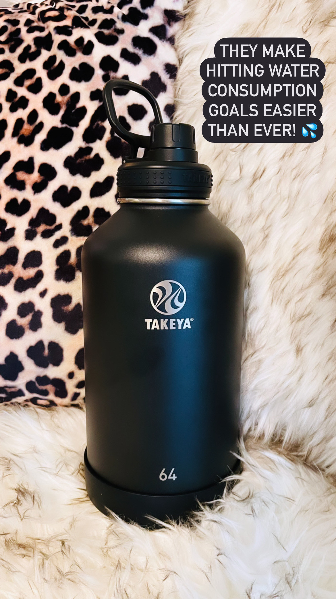 """Black 64 ounce Takeya water bottle captioned """"the make hitting water consumption goals easier than ever"""""""