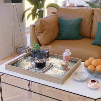 a living room with the serving tray sitting on a coffee table