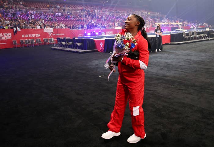 Simone holding a bouquet of flowers at the Olympic trials