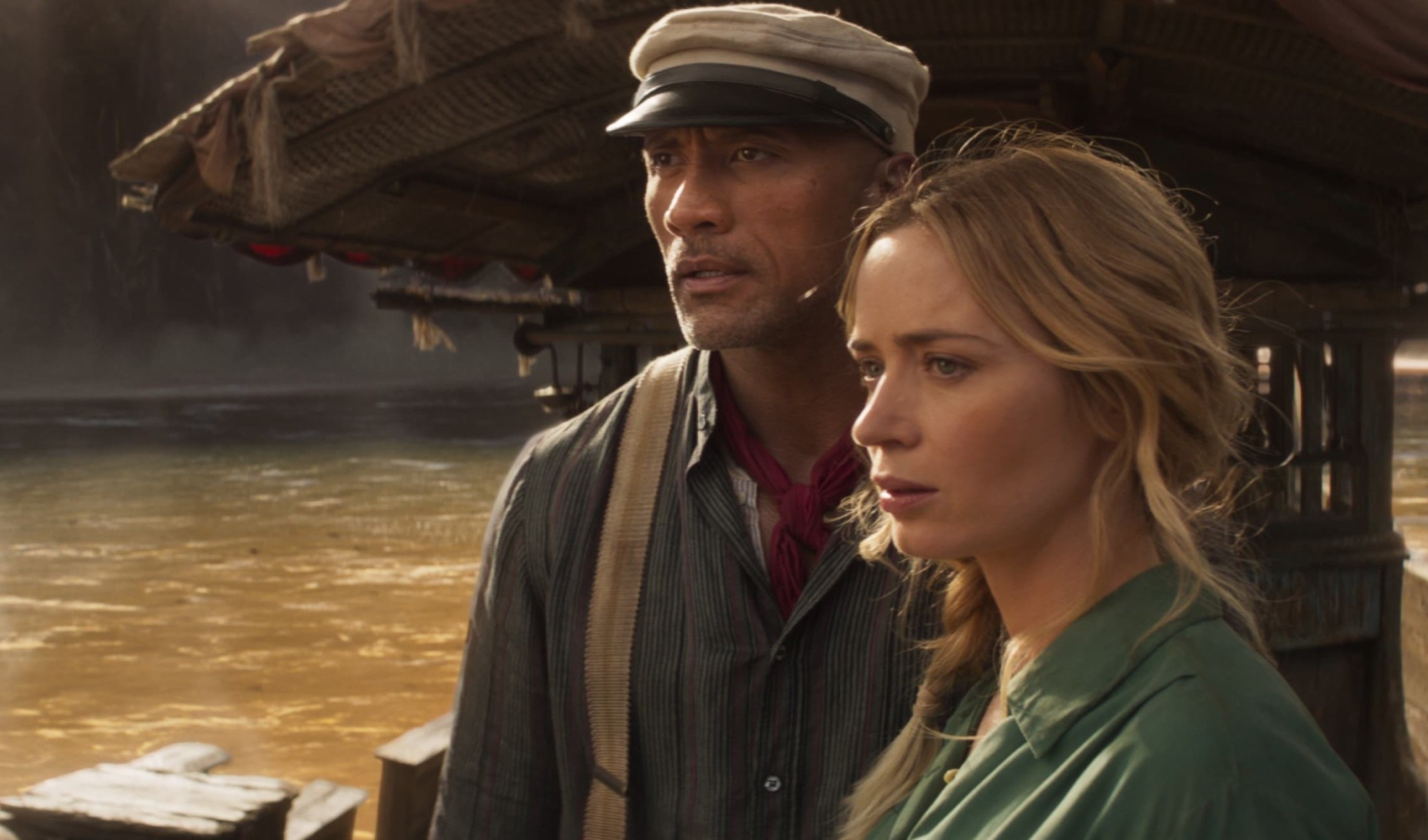 Dwayne Johnson and Emily Blunt looking slightly concerned on a jungle cruise