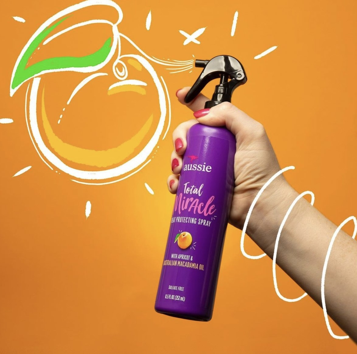 A bottle of heat protectant spray