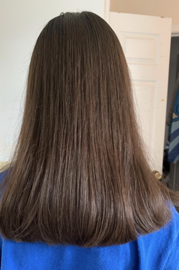 A reviewer's hair that was cut with the shears