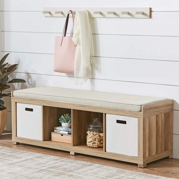 The four-cube bench in brown with two white storage cubes in it