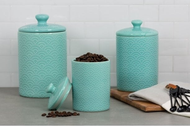 The canisters in tide blue in the kitchen