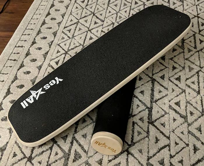 The board in black with blonde-colored wood