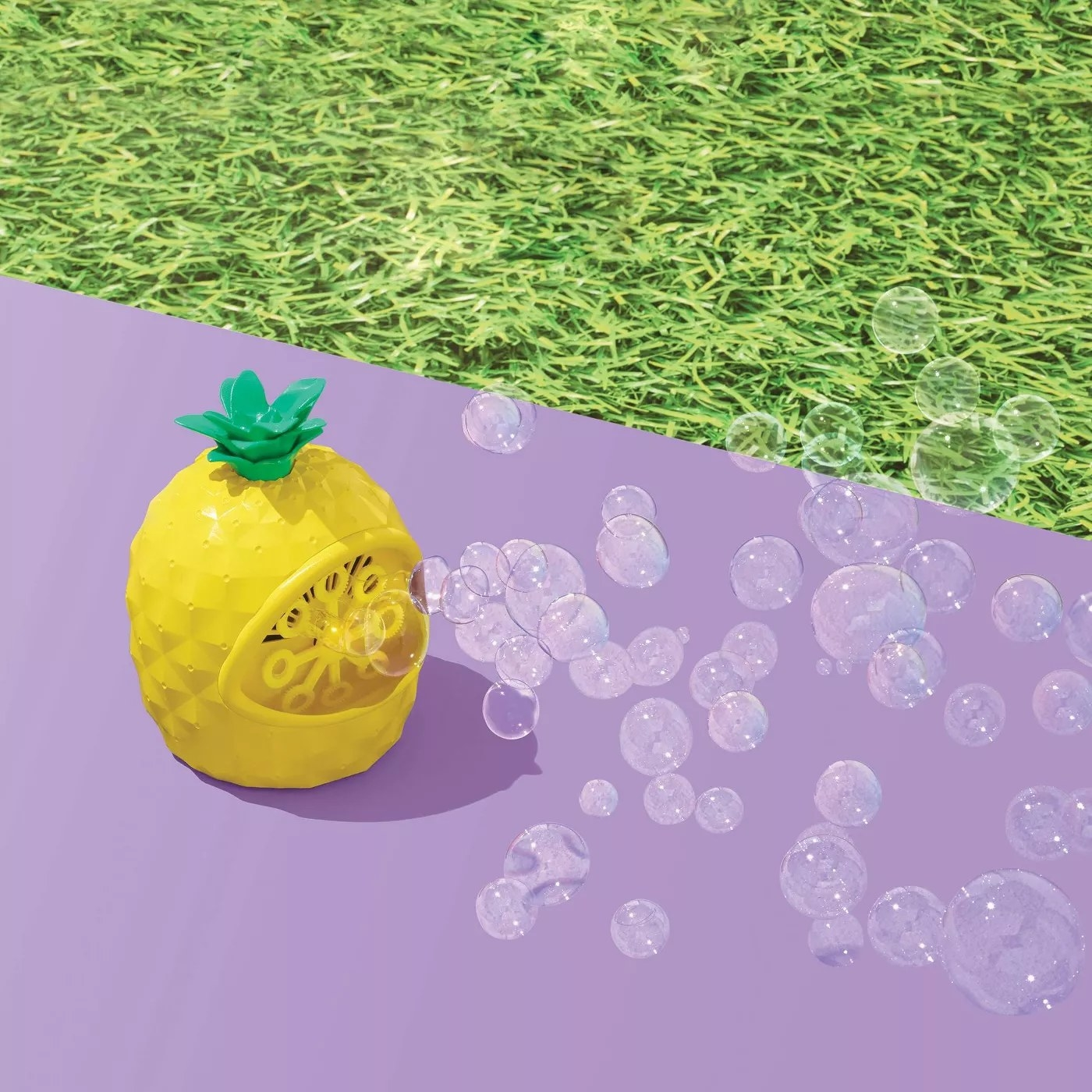 The pineapple bubble blower had a steady stream of bubbles coming out against a purple and grass background