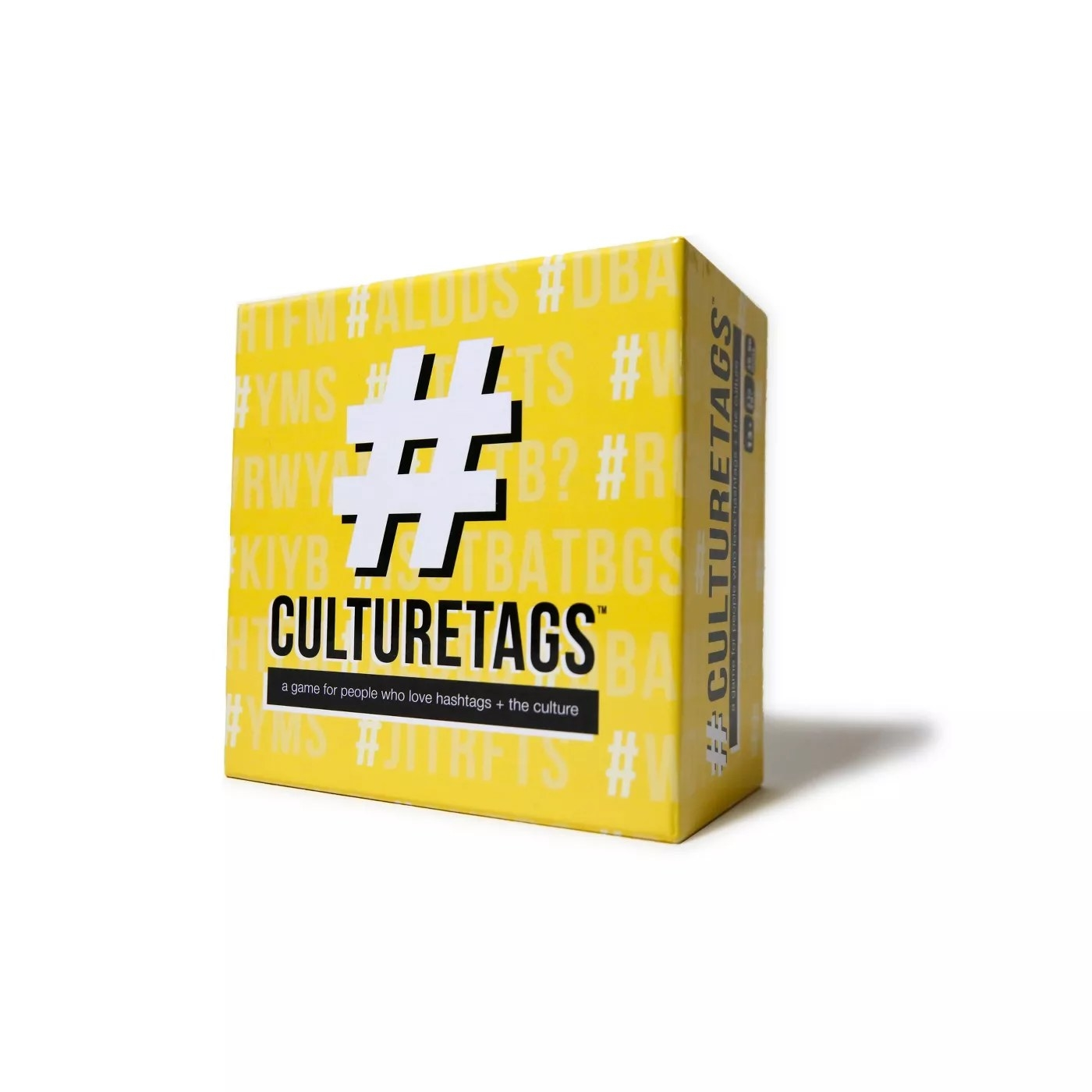 """The yellow game box is covered in hashtag symbols and says """"CULTURETAGS"""" and below """"a game for people who love hashtags + the culture"""""""