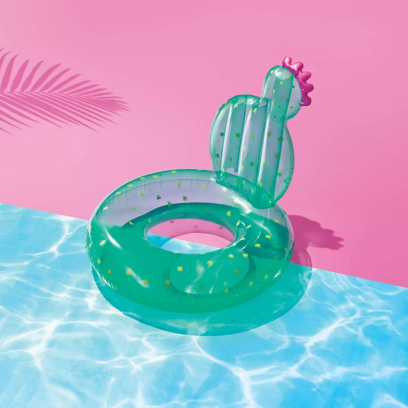 The cactus float is green with yellow spikes and a pink flower at the top