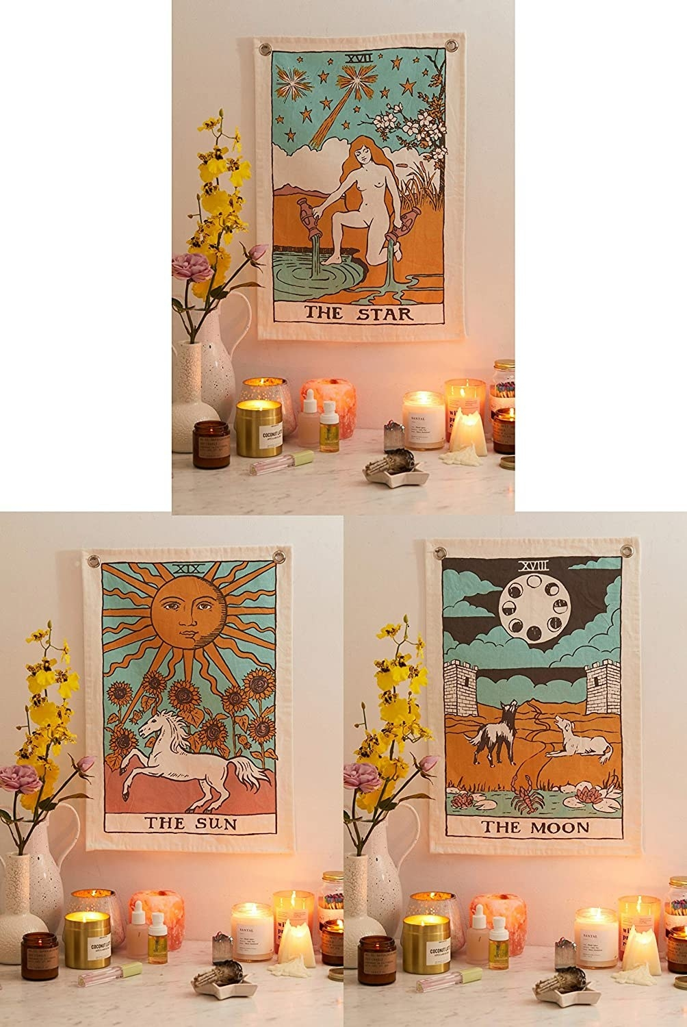 A set of wall hangings with Tarot cards on them surrounded by candles and flowers