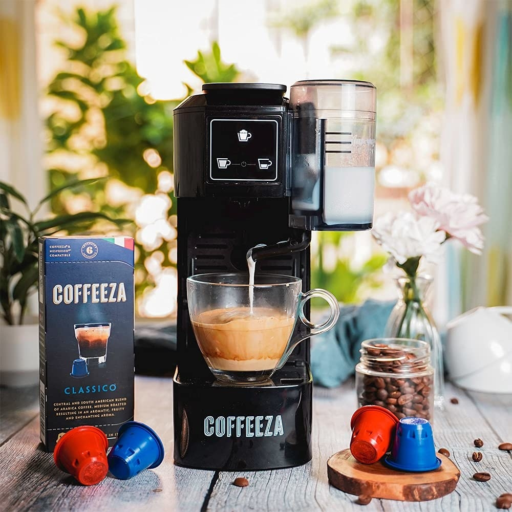 ACoffeeza Lattisso one-touch cappuccino coffee machine with brewed coffee and coffee capsules.