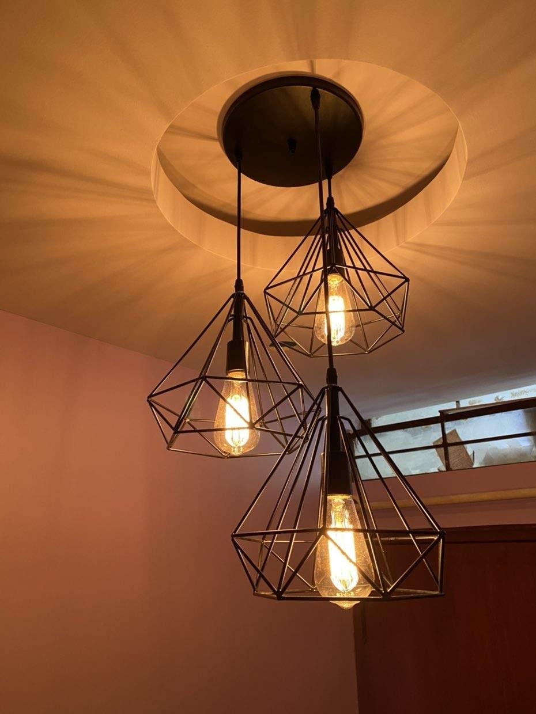 A set of black geometric pendant lights