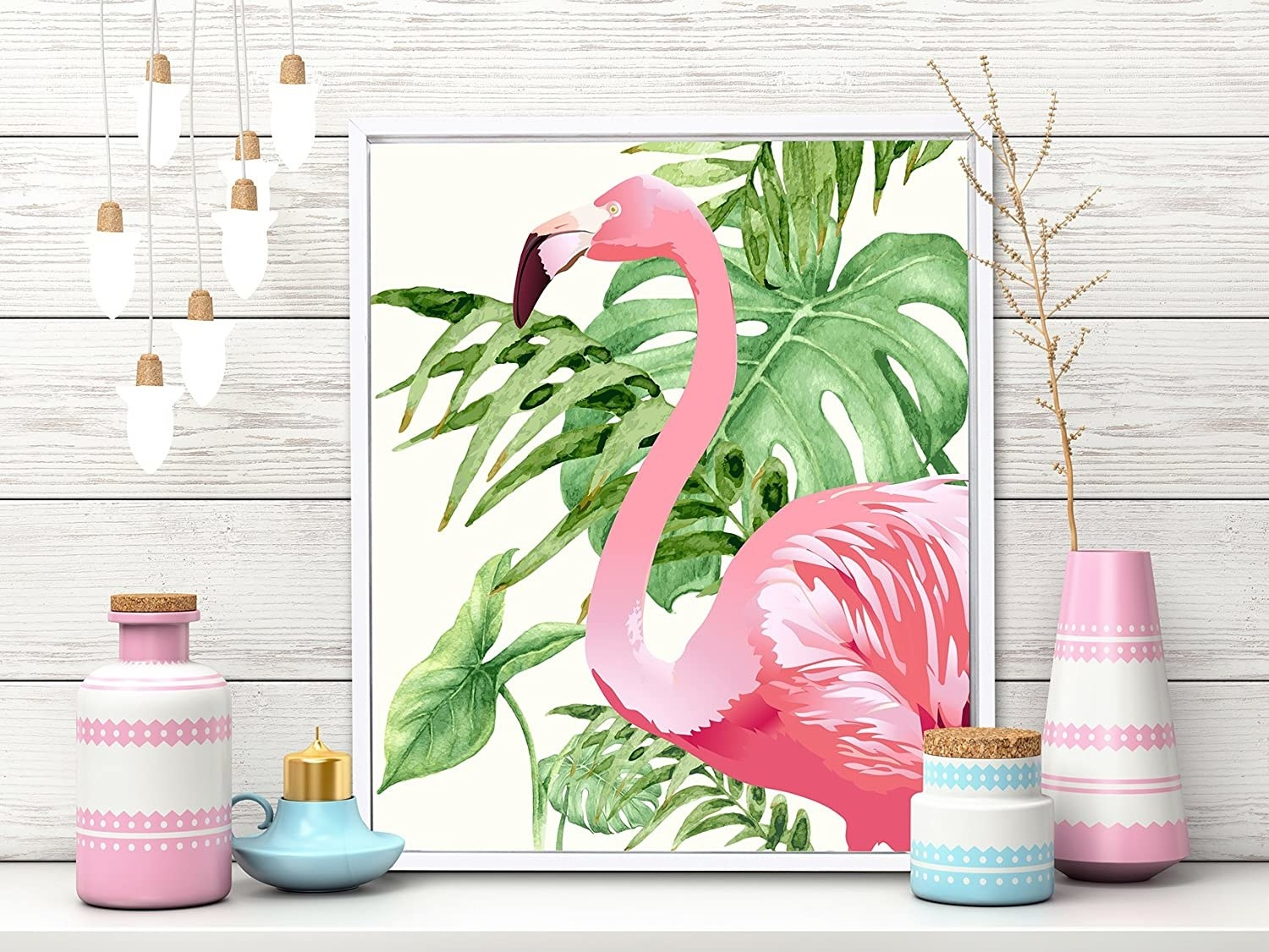 A flamingo painting surrounded by flower pots and bulbs