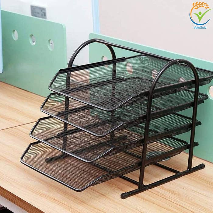 A 4-tier metal slot organiser on a wooden table.