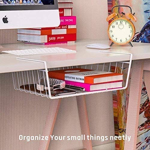 A white metal storage basket attached to the end of a shelf.