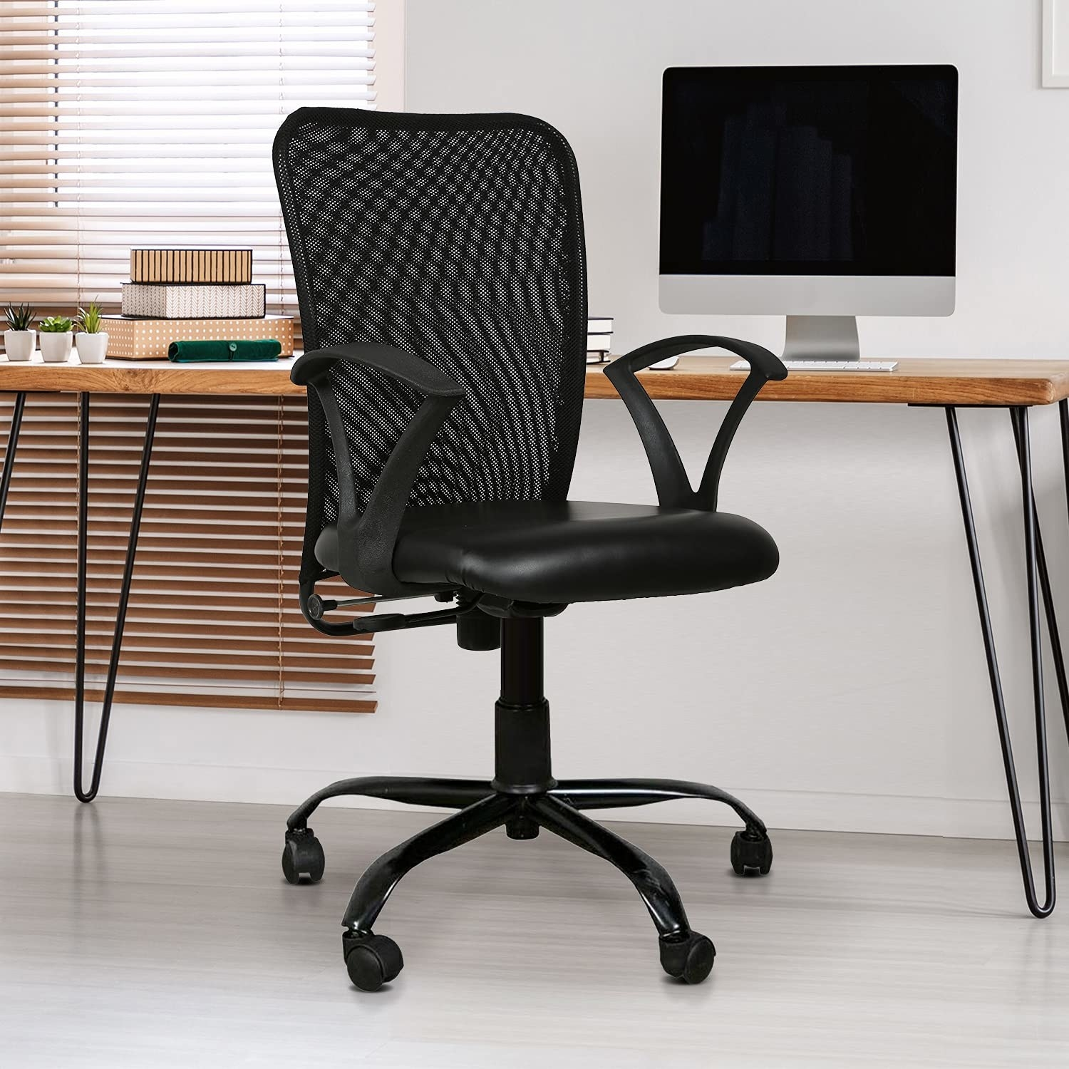 A black chair with wheels.