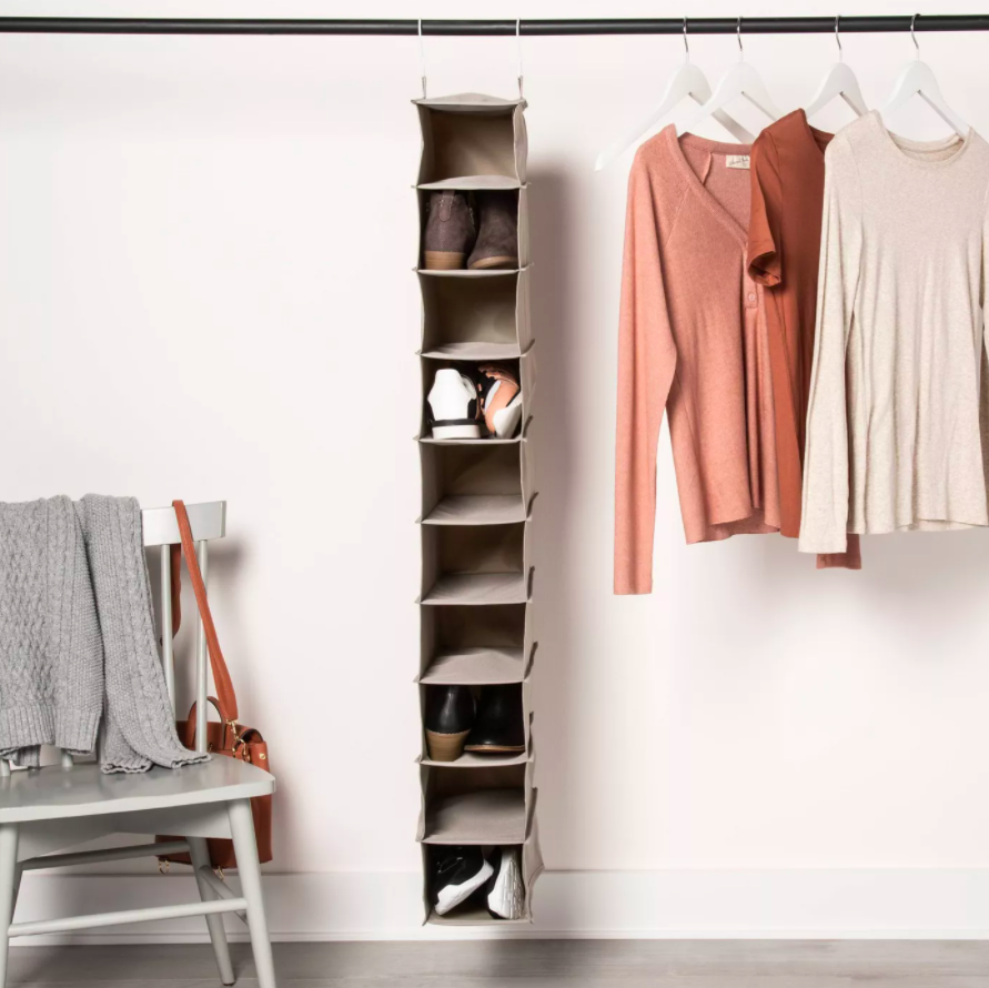 vertical organizer with square open compartments with shoes tucked into a few of them