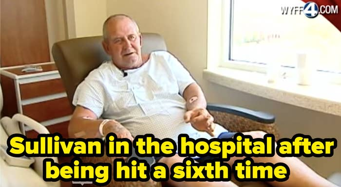Sullivan sits in a hospital gown in a hospital chair