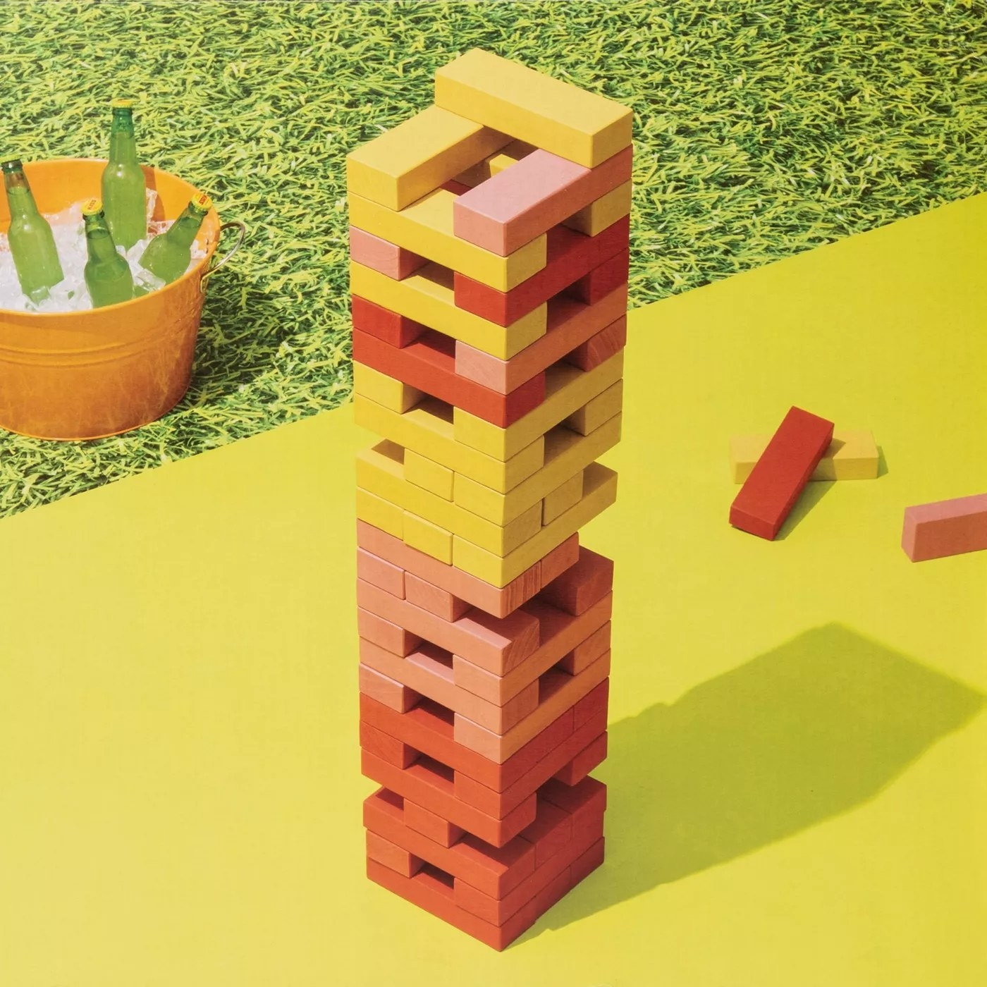 The jumbo tower has pink, red and yellow blocks