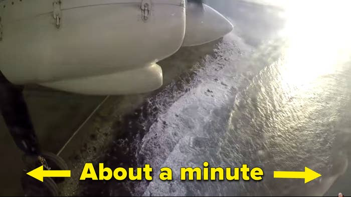 """A plane flies over a watery passage and the text """"about a minute"""""""