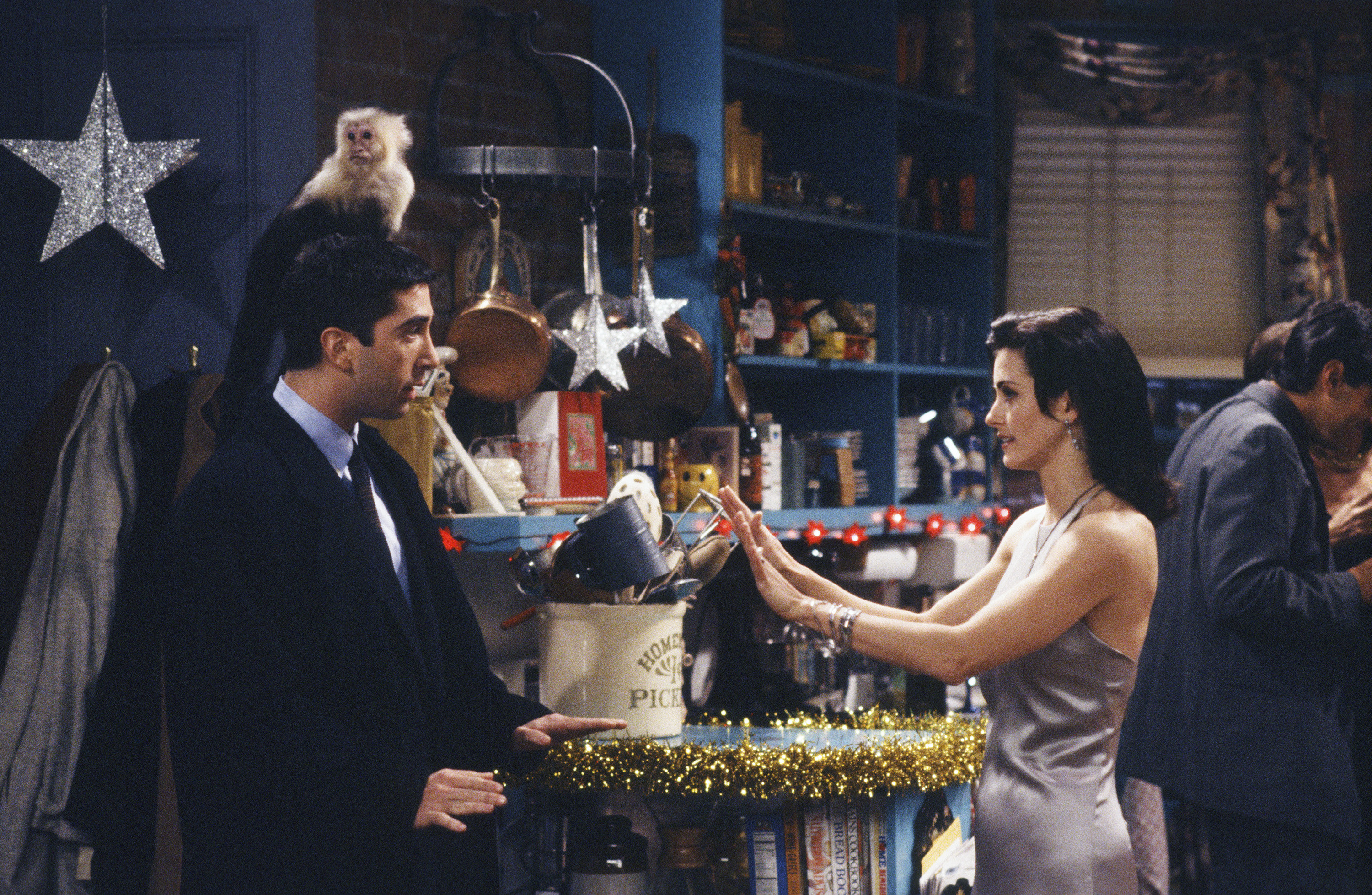 Monica puts her hands up as Ross approaches with the monkey