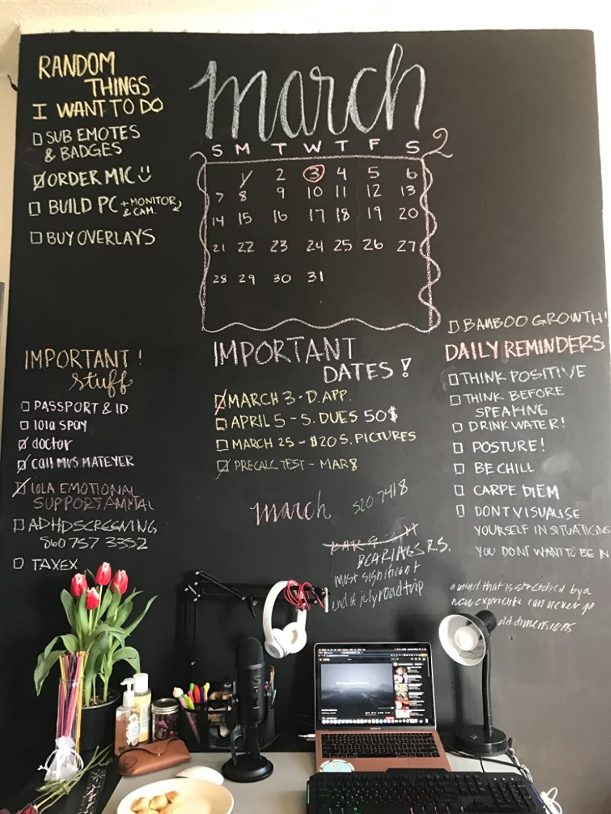 reviewer image of an office wall painted with black chalkboard paint, important dates and memos written in chalk