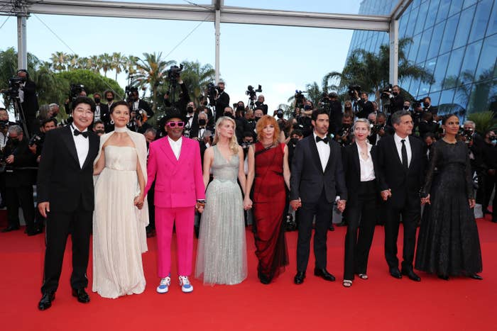 Spike Lee stands with Cannes jury members on the film festival's red carpet