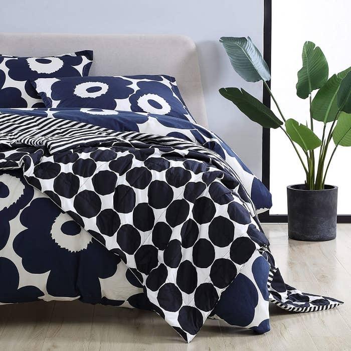 A Marimekko quilt draped over a large bed