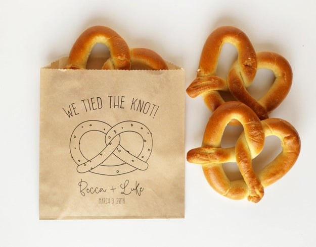 a favor bag with a pretzel illustration and the words we tied the knot
