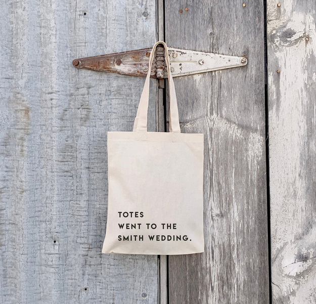 """a plain tote bag that says """"totes went to the smith wedding"""""""