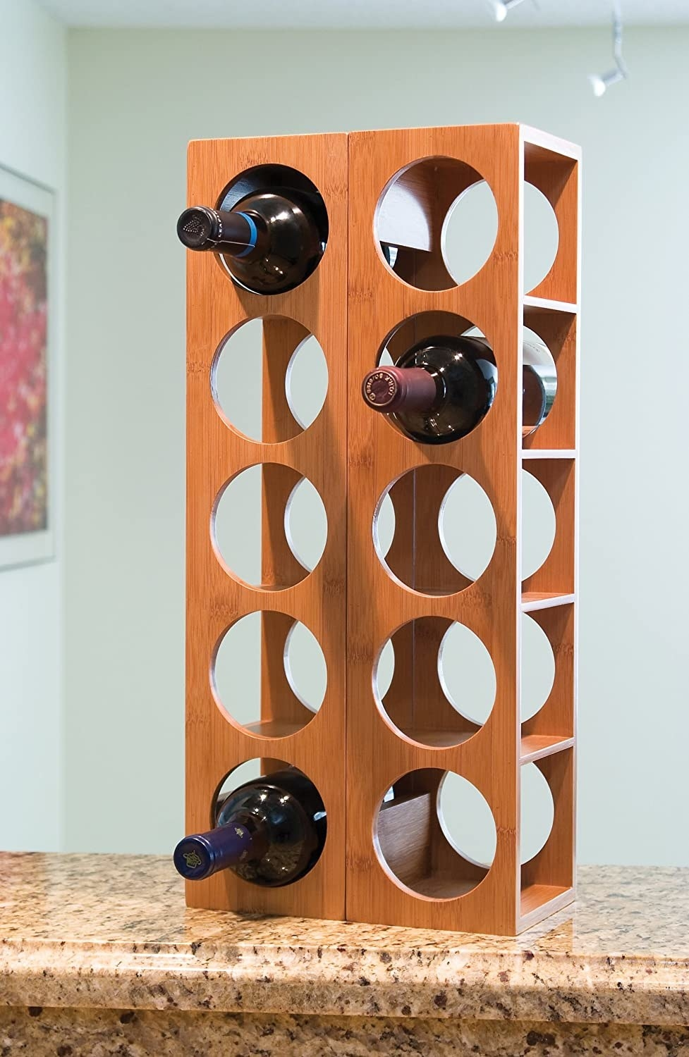 two of the wine racks stacked next to each other with one wine bottle in each side