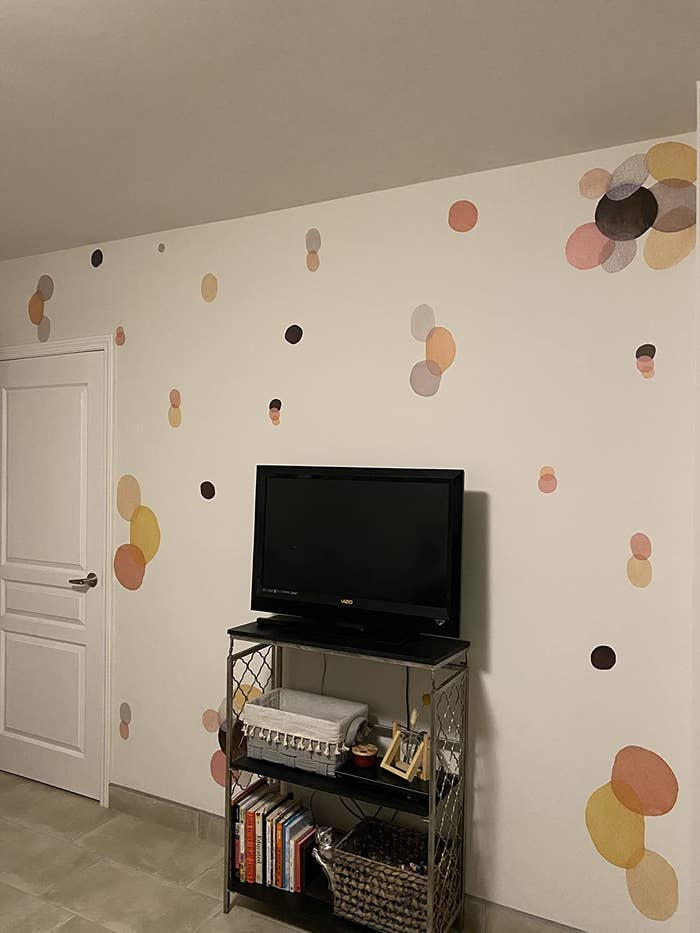 reviewer image of several abstract watercolor decals on a wall