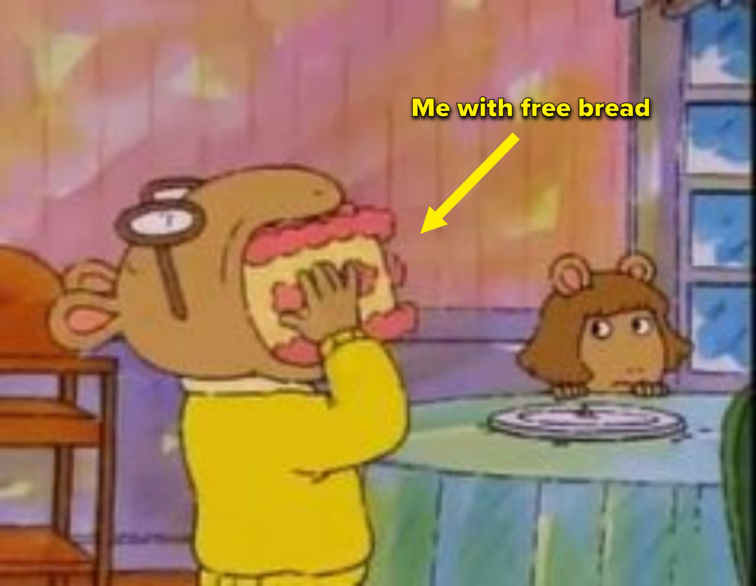 """Arthur stuffing a whole cake in his mouth with the caption """"Me with free bread"""""""