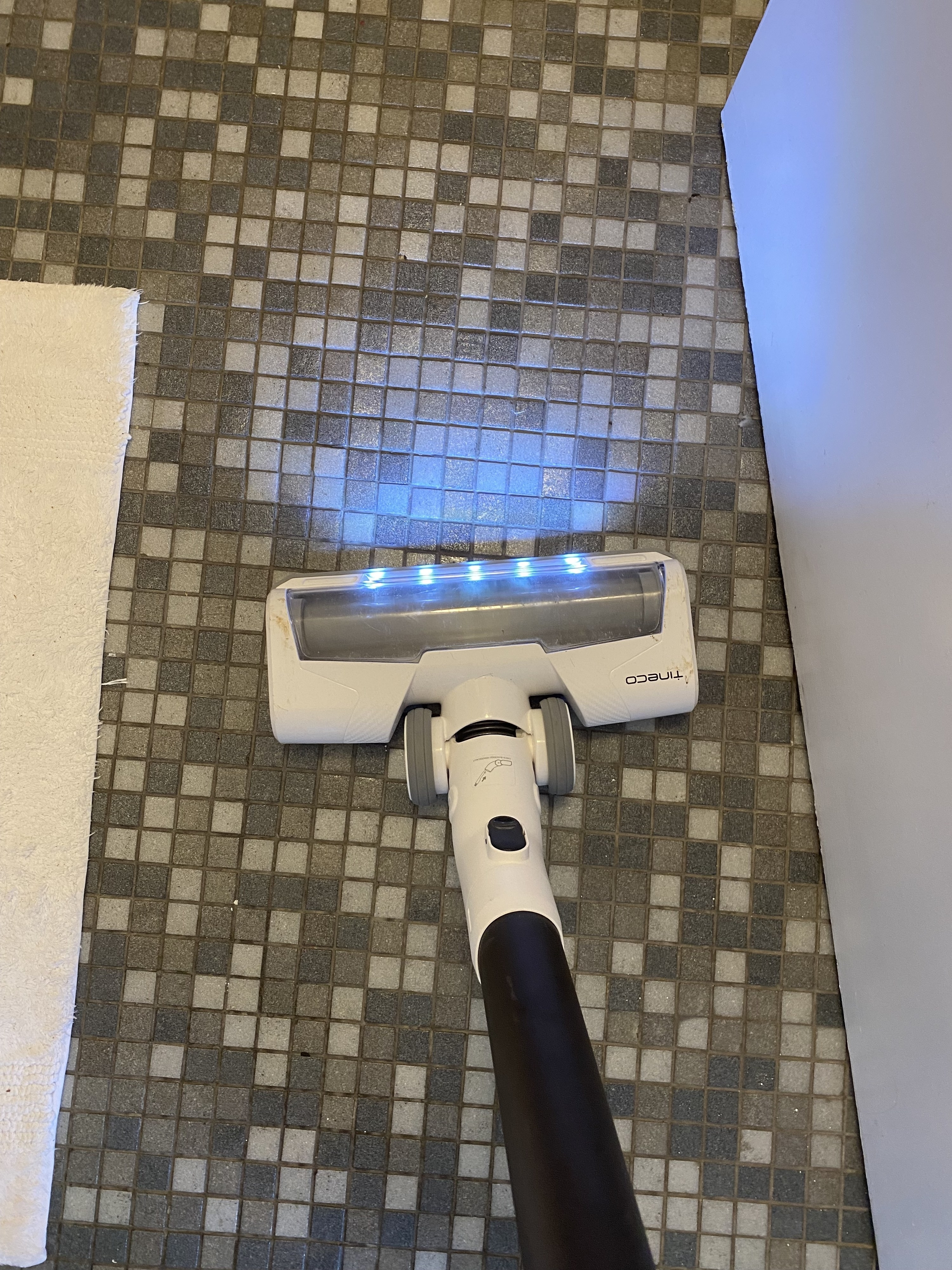 the Tineco being used on a tile bathroom floor