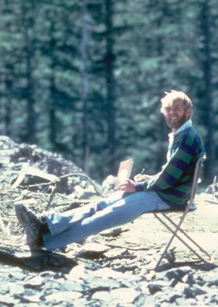 American volcanologist, David A. Johnston sitting at the Mount St. Helens eruption site in 1980