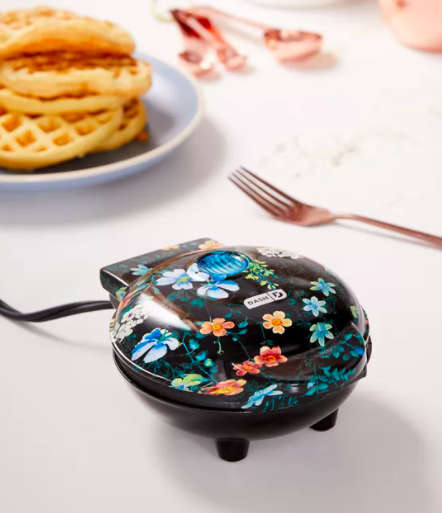 A close up of the mini waffle maker; it has a floral pattern