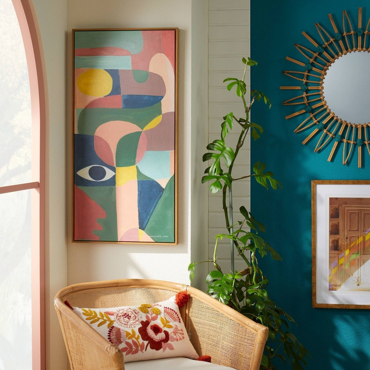 abstract framed artwork hanging on a white wall
