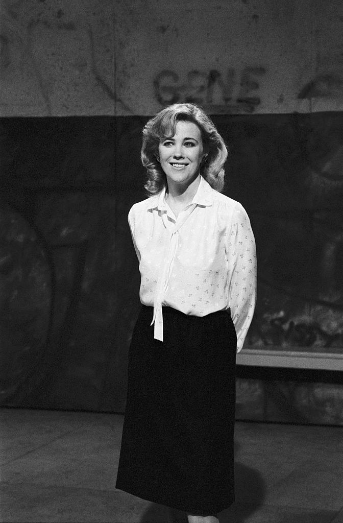 Black and white photo in 1984, wearing a prim blouse